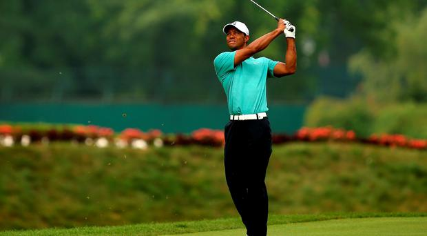 Tiger Woods takes his second shot on the 17th hole during the first round of the Greenbrier Classic at the Old White TPC on July 2 in White Sulphur Springs, West Virginia (Darren Carroll/Getty Images)