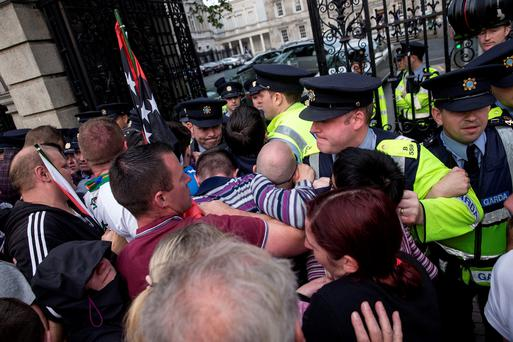 Protesters clash with gardaí as TDs try to leave Leinster House. Photo:Arthur Carron
