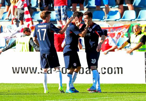 St Patrick's Athletic's Aaron Greene, right, is congratulated by team-mates after scoring his side's first goal