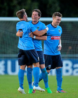 Mark Langtry, left, and Tomas Boyle, UCD, celebrate after the game