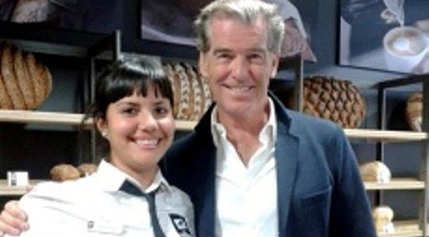 Pierce Brosnan at Natural Bakery with staff member Stephanie Juarez