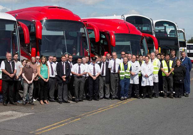 Staff at Bus Eireann in Broadstone, Dublin hold a minute's silence for Inspector Larry Hayes and his wife Martina at 11am for their funeral mass in Athlone. Pic:Mark Condren