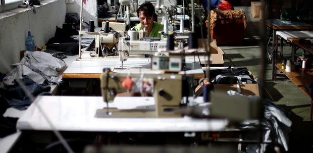 An employee sews while working in a factory in the city of Blagoevgrad, Bulgaria July 2, 2015. Greece is the third-largest investor in Bulgaria and is also Bulgaria's fourth-largest export destination. Picture taken on July 2, 2015. To match EUROZONE-GREECE/BULGARIA REUTERS/Stoyan Nenov