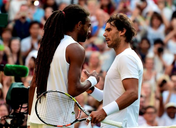 Rafael Nadal and Dustin Brown following their match during day Four of the Wimbledon Championships at the All England Lawn Tennis and Croquet Club, Wimbledon. PRESS ASSOCIATION Photo. Picture date: Thursday July 2, 2015. See PA Story TENNIS Wimbledon. Photo credit should read Adam Davy/PA Wire. RESTRICTIONS: Editorial use only. No commercial use without prior written consent of the AELTC. Still image use only - no moving images to emulate broadcast. No superimposing or removal of sponsor/ad logos. Call +44 (0)1158 447447 for further information.