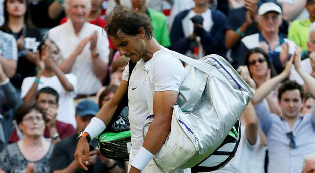 Rafael Nadal of Spain prepares to walk off court after losing his match against Dustin Brown of Germany