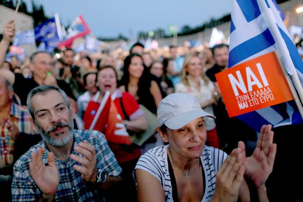 'Yes' supporters applaud during a pro-Euro rally in front of the Panathenean stadium in Athens, Greece