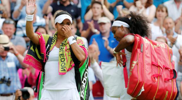 Heather Watson of Britain waves to the fans after losing her match to Serena Williams of the U.S.A. (R) at the Wimbledon Tennis Championships in London, July 3, 2015. REUTERS/Suzanne Plunkett