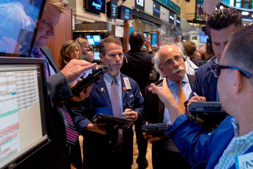 Traders work on the floor of the New York Stock Exchange in New York, United States, July 2, 2015. REUTERS/Brendan McDermid