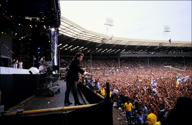 Career changing decision: Bono on stage at Wembley in 1985 shortly before he headed toward the crowd . Photo: Georges De Keerle/Getty Images