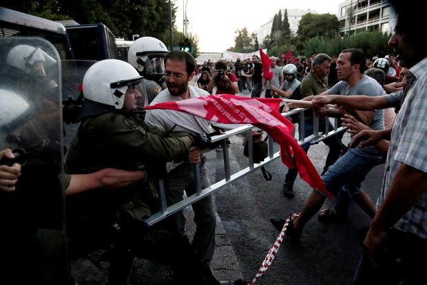 Anti-Euro protesters scuffle with riot police at the European Union Representation offices in Athens