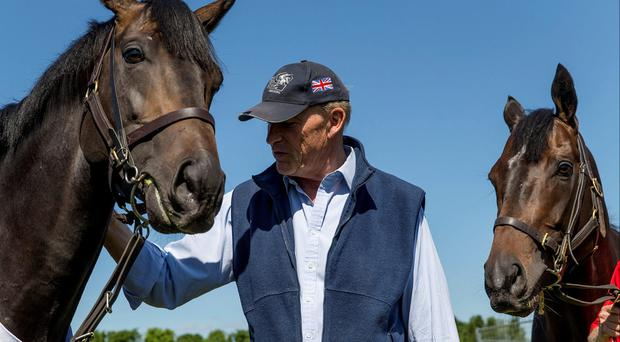 Trainer John Gosden with his Epsom Derby winner Golden Horn. Both are worth following at Sandown today