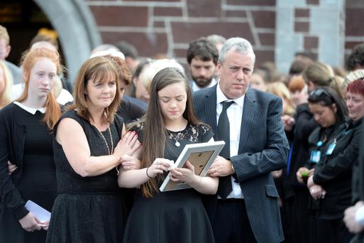 Paul and Catherine (parents) and sister of Niamh O'Connor grieve as her remains are carried from The Sacred Heart Church, Glounthaune, Co. Cork Pic Michael Mac Sweeney/Provision