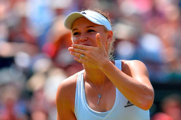 Denmark's Caroline Wozniacki blows a kiss as she celebrates beating Italy's Camila Giorgi during their women's singles third round match on day six of the 2015 Wimbledon Championships
