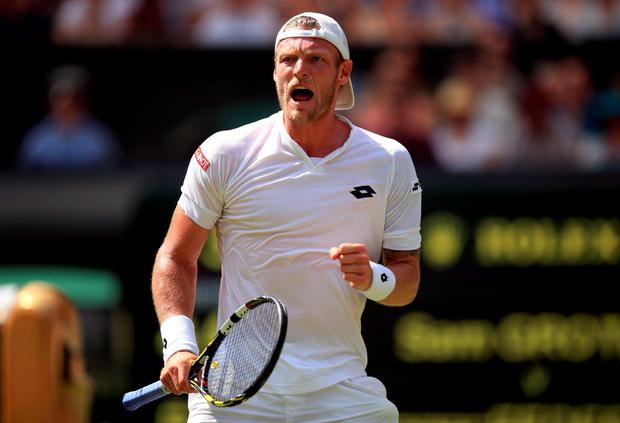 Sam Groth celebrates winning the third set against Roger Federer during day Six of the Wimbledon Championships at the All England Lawn Tennis and Croquet Club, Wimbledon. PRESS ASSOCIATION Photo. Picture date: Saturday July 4, 2015. See PA Story TENNIS Wimbledon. Photo credit should read: Mike Egerton/PA Wire. RESTRICTIONS: Editorial use only. No commercial use without prior written consent of the AELTC. Still image use only - no moving images to emulate broadcast. No superimposing or removal of sponsor/ad logos. Call +44 (0)1158 447447 for further information.