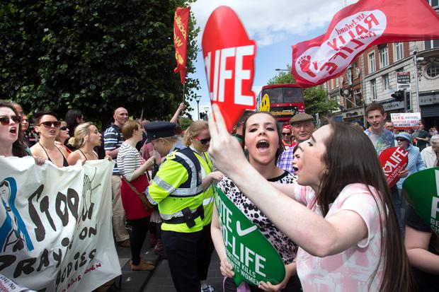 Pro Choice and Pro Life supporters clash on O'Connell Street yesterday. Photo: Tony Gavin 4/7/2015