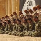 Child soldiers were forced to execute a group of more than 25 soldiers in Palmyra
