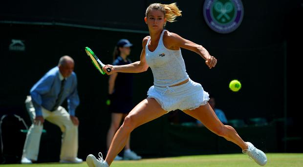 Italy's Camila Giorgi returns against Denmark's Caroline Wozniacki during their women's singles third round match on day six of the 2015 Wimbledon Championships at The All England Tennis Club in Wimbledon, southwest London, on July 4, 2015. RESTRICTED TO EDITORIAL USE -- AFP PHOTO / GLYN KIRKGLYN KIRK/AFP/Getty Images