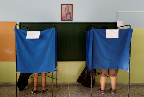 Athenians are seen inside polling booths at a school in Athens, Greece July 5, 2015. REUTERS/Yannis Behrakis