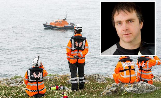 Funeral of Mr Barry Ryan (51), inset, as search for his son continues outside Baltimore Harbour
