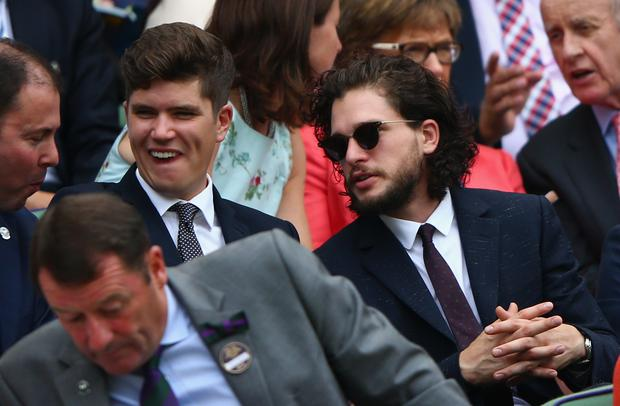 Actor Kit Harington (R) sits on Centre Court during day four of the Wimbledon Lawn Tennis Championships at the All England Lawn Tennis and Croquet Club on July 2, 2015 in London, England. (Photo by Ian Walton/Getty Images)