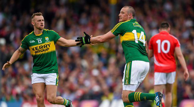 Kieran Donaghy is congratulated by his Kerry team-mate Barry John Keane, left, after scoring his side's first goal