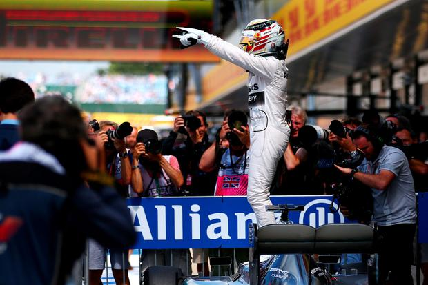 NORTHAMPTON, ENGLAND - JULY 04: Lewis Hamilton of Great Britain and Mercedes GP celebrates in Parc Ferme after claiming pole position during qualifying for the Formula One Grand Prix of Great Britain at Silverstone Circuit on July 4, 2015 in Northampton, England. (Photo by Dan Istitene/Getty Images)