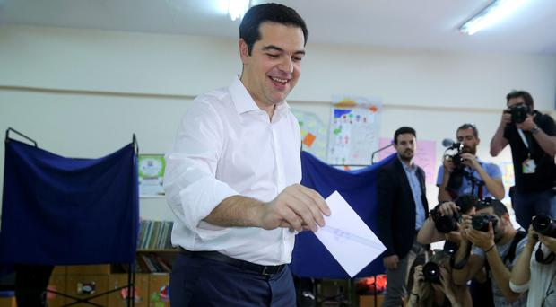 Greek Prime Minister Alexis Tsipras votes at a polling station in Athens