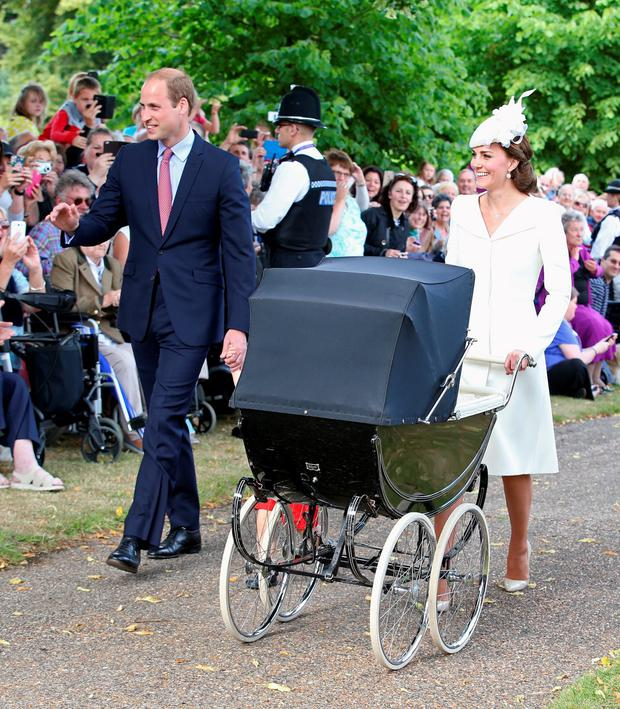 Catherine, Duchess of Cambridge, Prince William, Duke of Cambridge, Princess Charlotte of Cambridge and Prince George of Cambridge arrive at the Church of St Mary Magdalene on the Sandringham Estate for the Christening of Princess Charlotte of Cambridge on July 5, 2015 in King's Lynn, England. (Photo by Chris Jackson - WPA Pool/Getty Images)