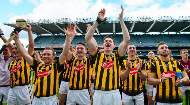Kilkenny players, from left, Cillian Buckley, Richie Hogan, Paul Murphy, TJ Reid, Eoin Larkin, and Conor Fogarty cheer on their captain Joey Holden as he raises the cup
