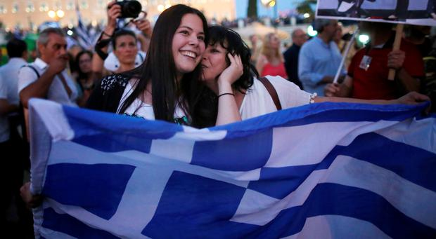 People celebrate in front of the Greek parliament as early opinion polls predict a win for the Oxi, or No, campaign in the Greek austerity referendum. Photo: Christopher Furlong/Getty Images)