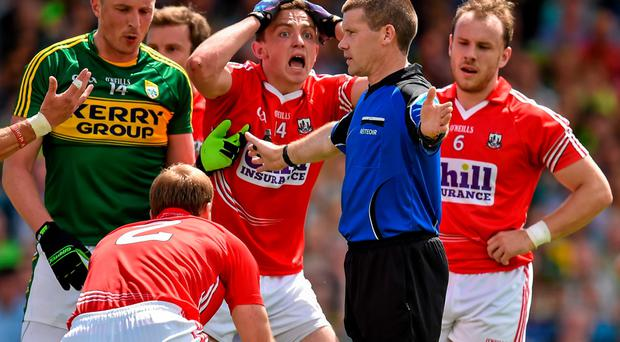 Cork's Mark Collins, 3rd from right, reacts as referee Padraig Hughes awards a penalty to Kerry