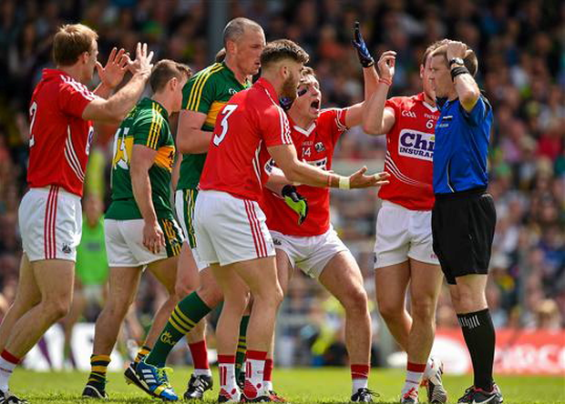 Cork players, including Michael Shields, Eoin Cadogan, Mark Collins and Brian O'Driscoll react as referee Padraig Hughes awards a penalty to Kerry