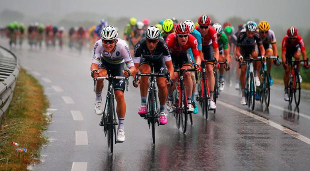 Michal Kwiatkowski of Poland and Etixx-Quick Step (L) rides through the rain with the peloton during stage two of the 2015 Tour de France, a 166km stage between Utrecht and Zelande, on July 5, in Zelande, Netherlands (Bryn Lennon/Getty Images)