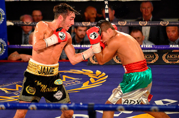Jamie Conlan, Northern Ireland, left, exchanges puches with Junior Granados, Mexico, during their flyweight bout. New Beginning Fight Night. National Stadium, Dublin (Cody Glenn / Sportsfile)
