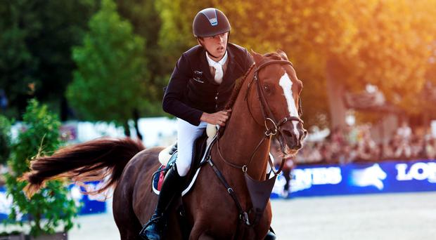 Irish horse driver Bertram Allen, riding Romanov, competes to win the Longines Global Champions Tour Grand Prix de Paris, during the second edition of the Longines Paris Eiffel Jumping tournament on July 4 on the Champ de Mars in Paris (Getty Images)