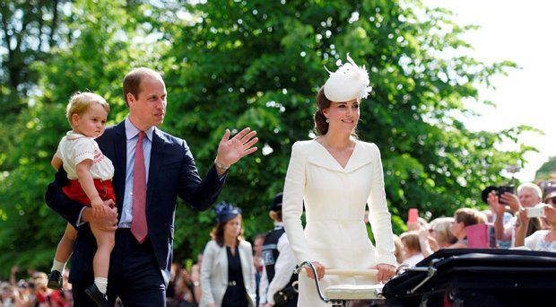 The Duke and Duchess of Cambridge walk past the crowds at the Church of St Mary Magdalene on the Sandringham Estate with their son Prince George and daughter Princess Charlotte, after her christening, on July 5th 2015