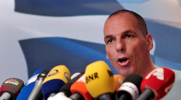 In this photo take on Sunday, July 5, 2015 Greece's Finance Minister Yanis Varoufakis makes statements at the Finance Ministry after the results of referendum in Athens. Greek Finance Minister Varoufakis announced on Monday, July 6, 2015 his resignation after 'no' vote against bailout. (AP Photo/Angelos Christofilopoulos)