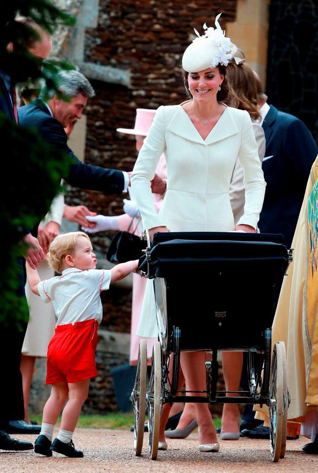 Britain's Catherine, Duchess of Cambridge, leaves with her daughter Princess Charlotte and her son Prince George after the christening of Princess Charlotte at the Church of St Mary Magdalene on the Sandringham Estate in King's Lynn July 5, 2015. REUTERS/Chris Jackson/Pool