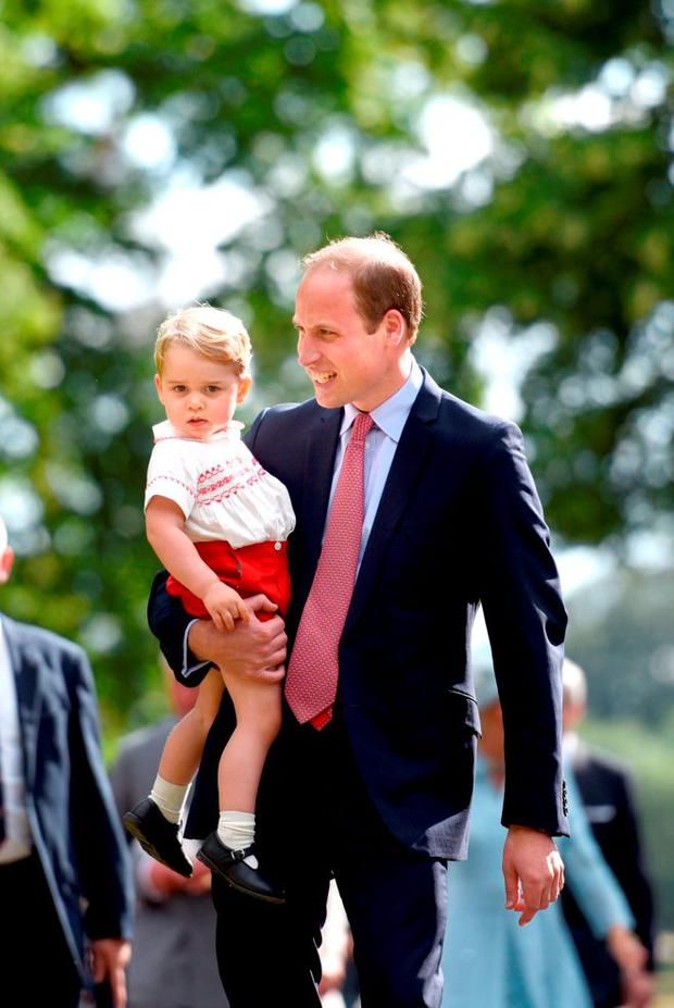 Britain's Prince William holds his son Prince George as they walk past the crowds after the christening of his daughter Princess Charlotte at the Church of St Mary Magdalene on the Sandringham Estate, July 5, 2015. REUTERS/Mary Turner/Pool