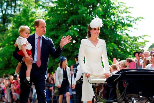 ***The Duke and Duchess of Cambridge walk past the crowds at the Church of St Mary Magdalene on the Sandringham Estate with their son Prince George and daughter Princess Charlotte, after her christening