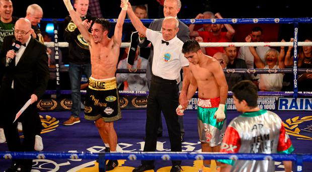 4 July 2015; Jamie Conlan, Northern Ireland, is declared the winner by unanimous decision over Junior Granados, Mexico, after their flyweight bout. New Beginning Fight Night. National Stadium, Dublin. Picture credit: Cody Glenn / SPORTSFILE
