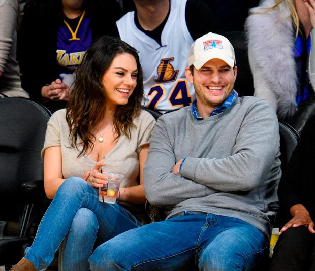 Mila Kunis (L) and Ashton Kutcher attend a basketball game between the Oklahoma City Thunder and the Los Angeles Lakers at Staples Center on December 19, 2014 in Los Angeles, California. (Photo by Noel Vasquez/GC Images)