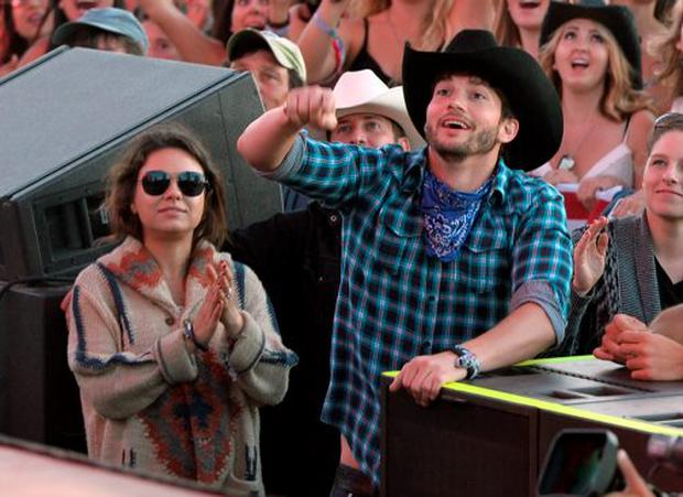 Actors Mila Kunis and Ashton Kutcher seen during day 3 of 2014 Stagecoach: California's Country Music Festival at the Empire Polo Club on April 27, 2014 in Indio, California. (Photo by Kevin Winter/Getty Images for Stagecoach)