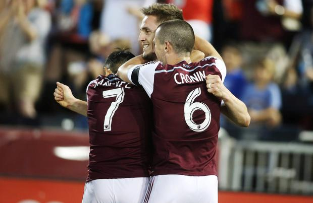 Colorado Rapids forward Kevin Doyle (9) is congratulated by forward Vicente Sanchez (7) and midfielder Sam Cronin (6) after scoring a goal during the second half against the Vancouver FC at Dick's Sporting Goods Park. The Rapids won 2-1
