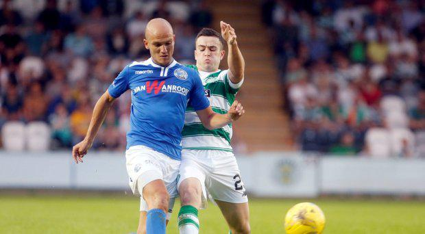 Celtic's Michael Duffy (right) and FC Den Bosch's Maarten Boddaert battle for the ball during the pre-season friendly game at St Mirren Park, Paisley
