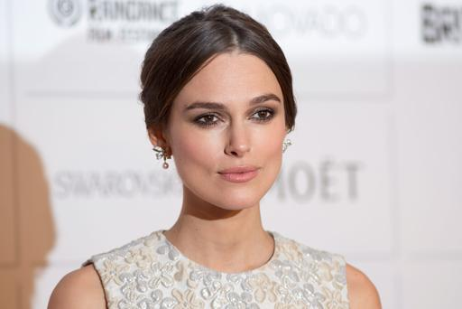 British actress Keira Knightley poses on the red carpet arriving for the British Independent Film Awards in London