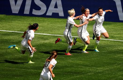 United States midfielder Carli Lloyd (10) celebrates with teammates after scoring against Japan