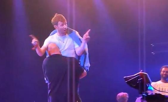 Damon Albarn being carried off stage at the Roskilde Music Festival in Denmark