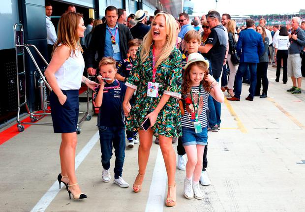 Geri Horner and Emma Bunton leave the Infiniti Red Bull Racing garage with Bluebell Halliwell, Beau Lee Jones, Cruz Beckham and Romeo Beckham before the Formula One Grand Prix of Great Britain at Silverstone Circuit on July 5, 2015 in Northampton, England. (Photo by Mark Thompson/Getty Images)