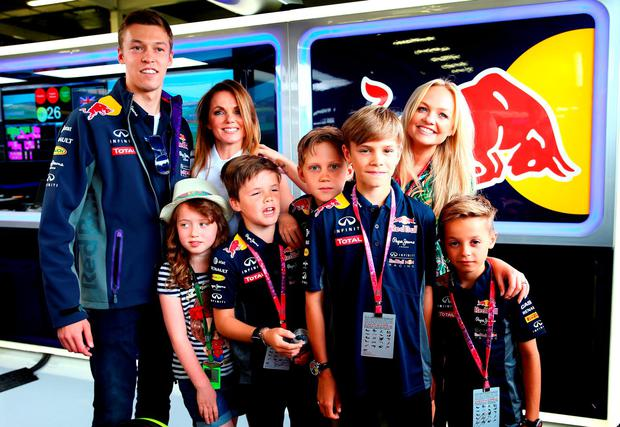 Daniil Kvyat of Russia and Infiniti Red Bull Racing poses with Geri Horner, Infiniti Red Bull Racing Team Principal Christian Horner, Emma Bunton, Romeo Beckham, Romeo Beckham, Cruz Beckham, Bluebell Halliwell, Beau Lee Jones and Finn Isted in the garage before the Formula One Grand Prix of Great Britain at Silverstone Circuit on July 5, 2015 in Northampton, England. (Photo by Mark Thompson/Getty Images)